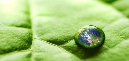 Water drop on a leaf with The Earth reflected inside. Earth picture from Nasa at http://earthobservatory.nasa.gov/